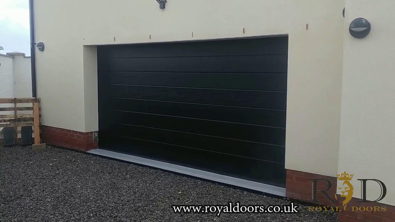 Sectional garage door in black woodgrain. Royal Doors & Sectional garage door in black woodgrain. - YouTube