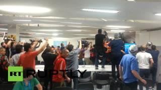 RAW: Chile football fans rampage, storm Maracana stadium