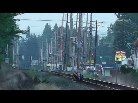 Thumbnail: Trespasser sits on main track, Amtrak on a slow order.