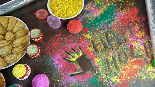 Zoom out shot of beautifully placed festive items for the joyful Indian festival - Holi