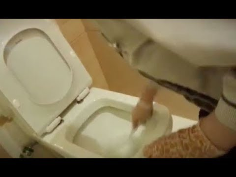 WATCH Shocking moment luxury hotel cleaners wash cups with a TOILET BRUSH