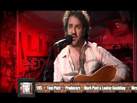 Ian Prowse- Does this train stop on Merseyside.