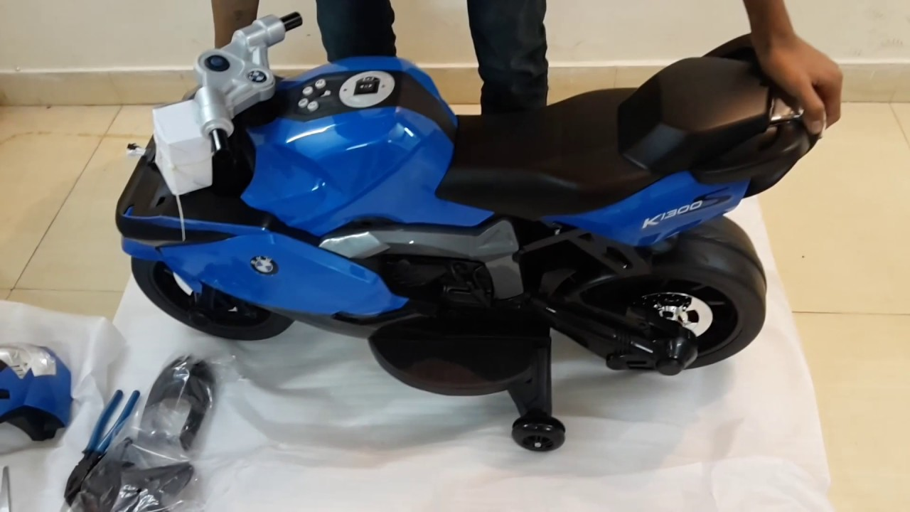 assembling of wheel power baby battery operated ride on bike bmw