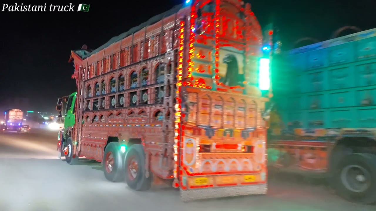 beautifull decorated trucks on road at night time