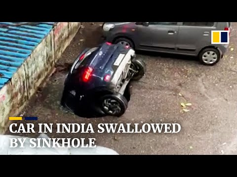 Parked car in India swallowed by sinkhole after heavy rain