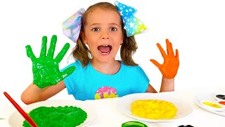 Max and Katya play with finger paints