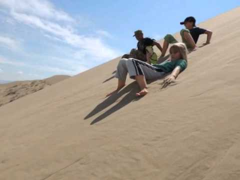 Sliding down the Singing Dune, Altyn Emel, Kazakhstan
