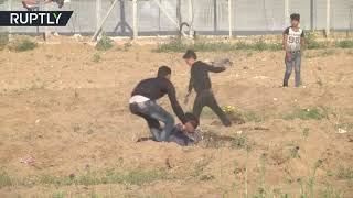 RAW: 48 Palestinians injured during clashes with IDF forces along Gaza border