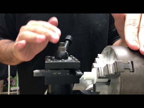 How to install a tip on a pool cue using a lathe