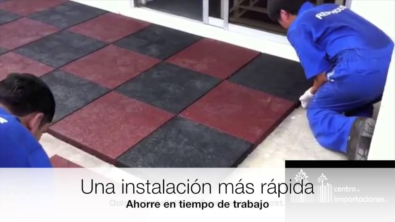 Colocaci n de baldosas de caucho youtube for Como poner baldosas en pared