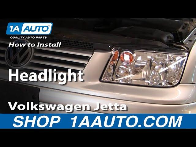 replace 2002 jetta headlight bulb