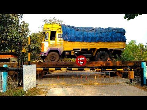 RORO Truck Train Through A Rural Railroad Level Crossing :: Indian Railways