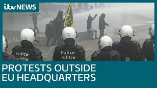 Tear gas used on anti-migration protesters at EU headquarters | ITV News