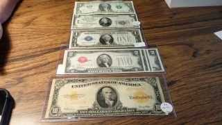 What are the colored seals on US paper money?