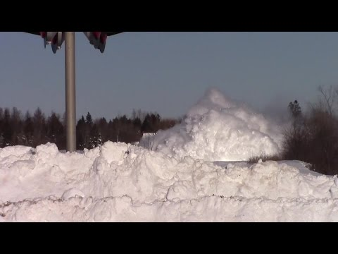 Thumbnail: Train plows through snow bank