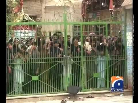 People protest outside the shrine of Lal Shahbaz Qalandar