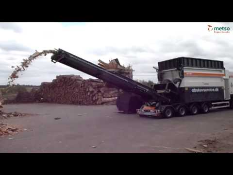 Industrial shredder shredding large wood waste