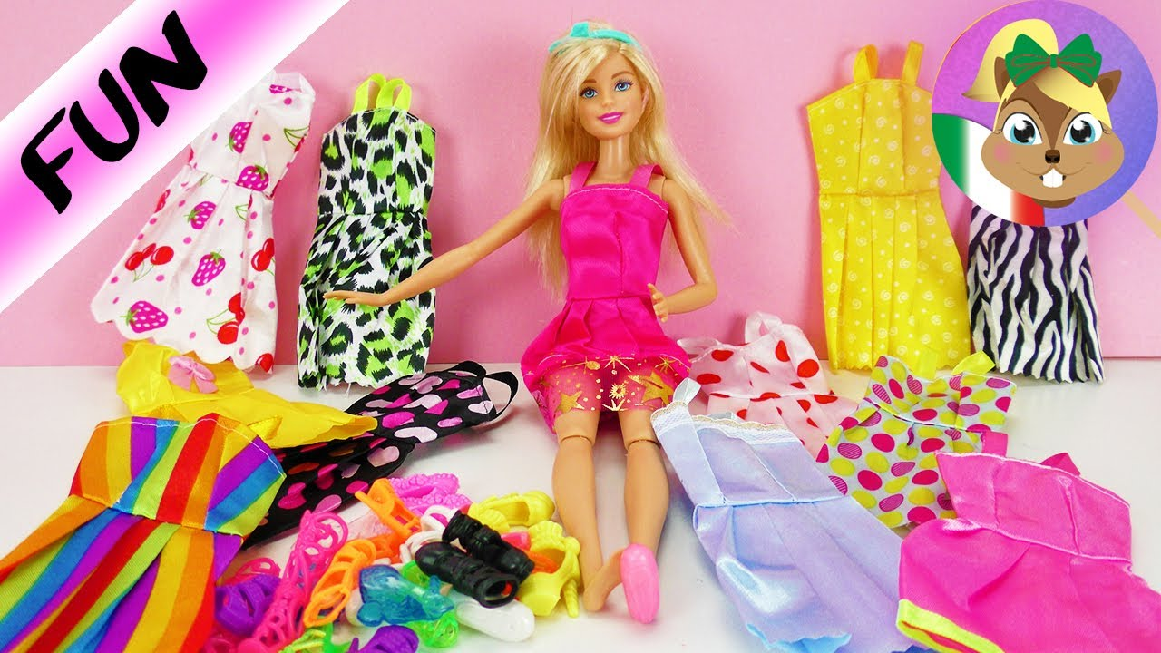 timeless design 0c28c 3926a BARBIE 12 outfit e 12 paia di scarpe per le tue bambole | Cambia vestiti  ogni giorno e decidi tu gli
