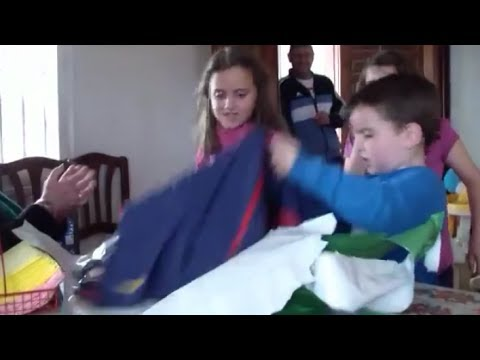 When a Real Madrid Kid Fan Receives a Barcelona Jersey For His Birthday !