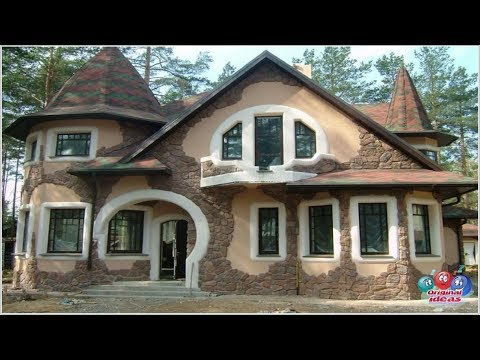 The design of the facade of a private house is stone decoration.