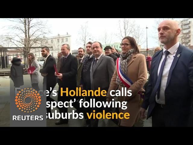 France's Hollande visits Paris suburb following violence