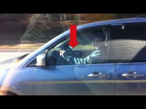 Maxim Magazine reading while driving