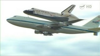 Shuttle Discovery in dramatic Washington flyover