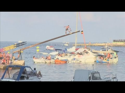 The devastating 200-year-old tradition of running along a greasy pole in Malta