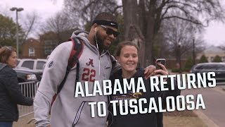 Watch the scene as the Alabama football team returns home to Tuscaloosa.