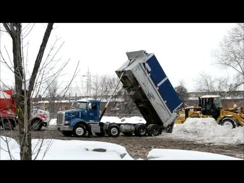 SNOW DUMPING SITE IN MONTREAL - DUMP TRUCKS & WHEEL LOADER ACTION