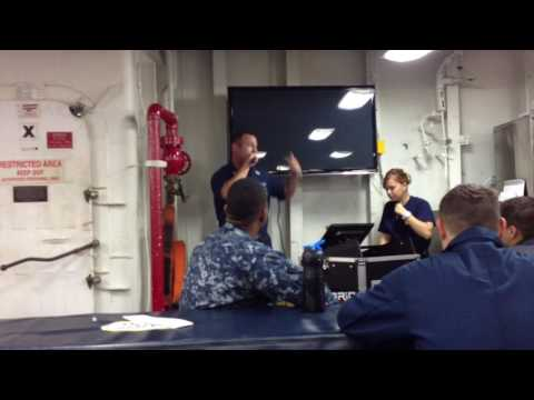 sailor doing karaoke on board navy ship
