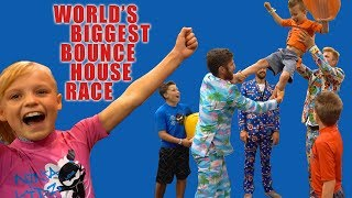 Worlds BIGGEST Bounce House Race! Ninja Kidz Tv