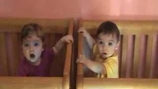 Twins Talking In Crib