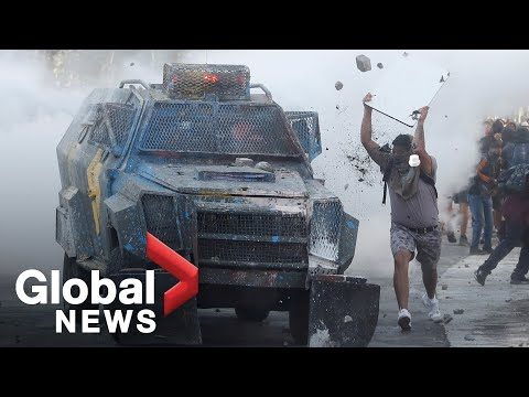 Chile Protests: Demonstrators clash with security force vehicles in Santiago