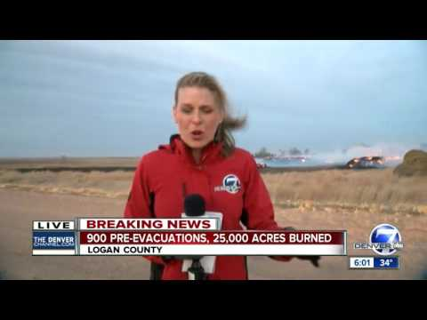 Schools evacuated as wildfire rips through Logan County; fire estimated at 25K acres