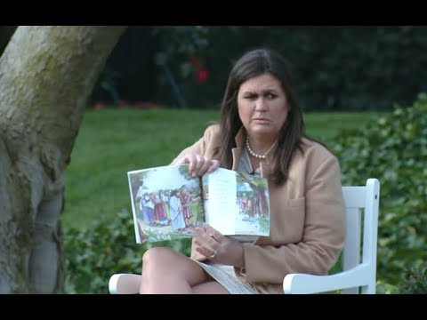 Image result for huckabee sanders reading religious book