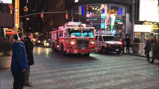 FDNY ENGINE 65 CRUISING BY ON WEST 43RD STREET IN THE MIDTOWN AREA OF MANHATTAN IN NEW YORK CITY.