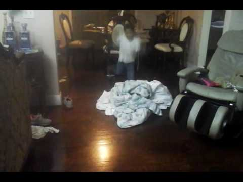 Little boy jumping over the blanket