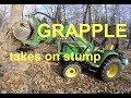 John Deere 3038E (tractor & grapple) - taking on a large stump