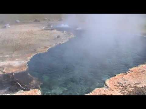 Yellowstone National Park - Mike touching the geyser water