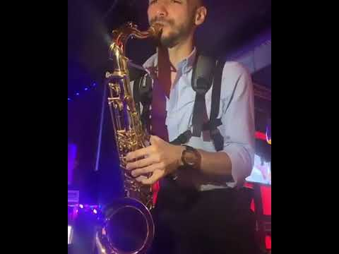 Live sax player with a cool DJ