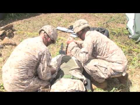 Mortar explodes, Marines rush simulated casualty into Shock Trauma Section during...