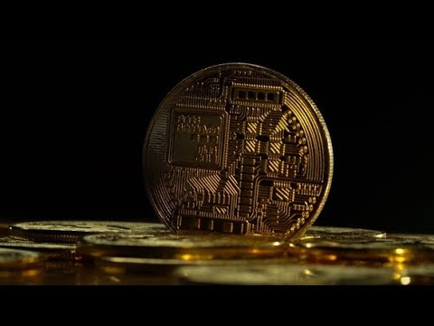 Gold Coins Of Bitcoin Peer-to-peer Payment System Are Spinning On A Black Background. | Stock