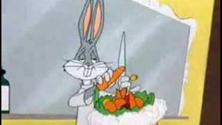 Bugs Bunny makes fruit salad on elmer fudds head