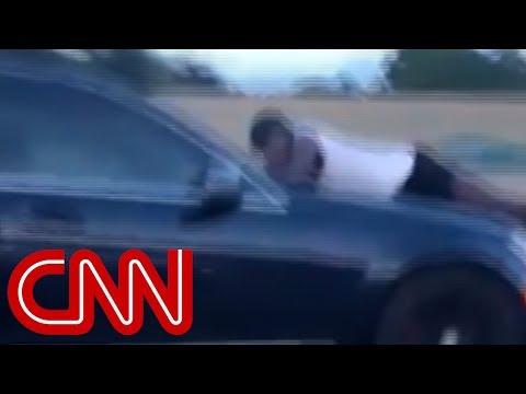 Man clings to car hood going 70mph