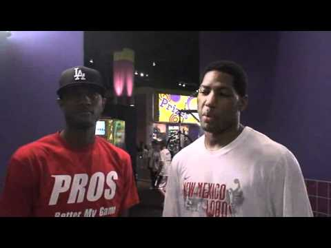 Teammate Paul George helps with the Danny Granger Basketball Camp 2011