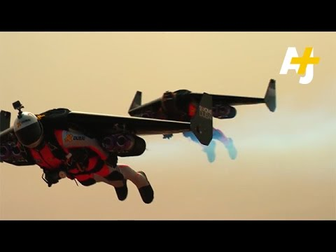 Watch Two Men With Jetpacks Fly Over Tallest Building In Dubai - Crazy video of two guys flying jetpacks over dubai