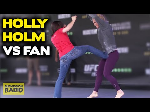 UFC 193: Holly Holm lets fan kick her during open workout!