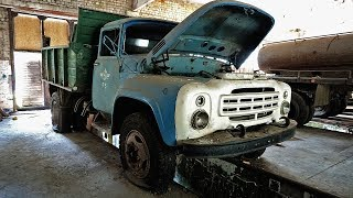 Russian ZIL-130 trucks are left in abandoned workshops
