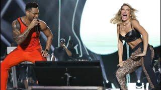Lore Improta dançando no palco com Tony Salles no Festival de Verão